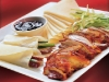 http://www.ifood.tv/blog/how-to-eat-peking-duck