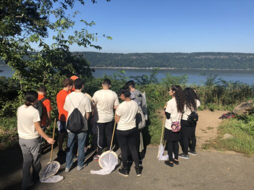 Students overlook the Hudson River from Inwood Hill Park