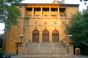 Exterior with column structures and gates, which are common to Brighton's synagogues