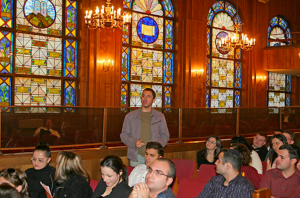 Ornate stain glass windows, dividers that normally separate men and women in Orthodox congregations