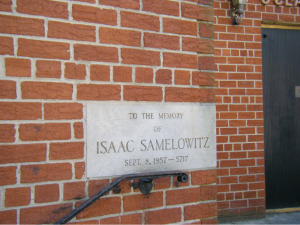 Stone memorial dedication to prominent member of the congregation, a common site in most Brighton synagogues.