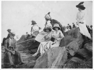 At picturesque Brighton, young people gather on a Brighton breakwater, July 8, 1912.