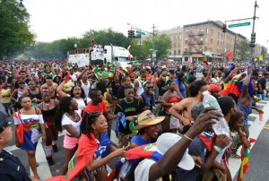 Parading the Eastern Parkway. Note the different nations represented in the crowd. (Anthony Delmundo/NY Daily News)