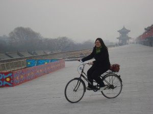 Winnie riding a bike on Xi'an's wall.