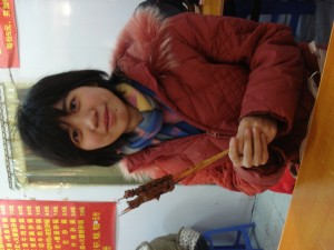 My friend Ruby, whom I met while in China, eating lamb on a stick. Mmmm. Delicious.