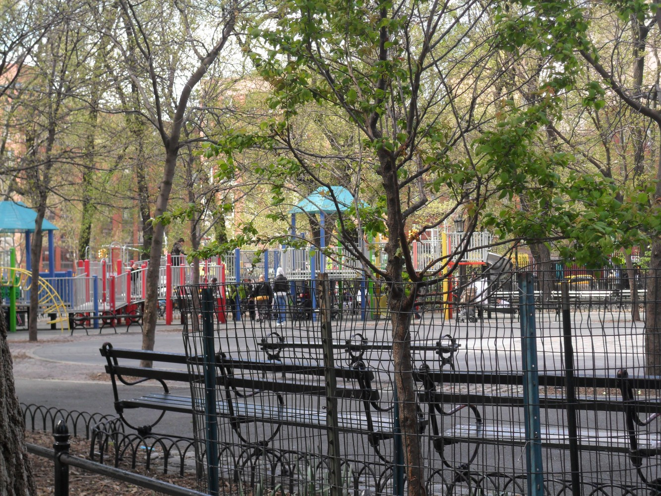 Everyone enjoys the playgrounds, benches and trees around the park!
