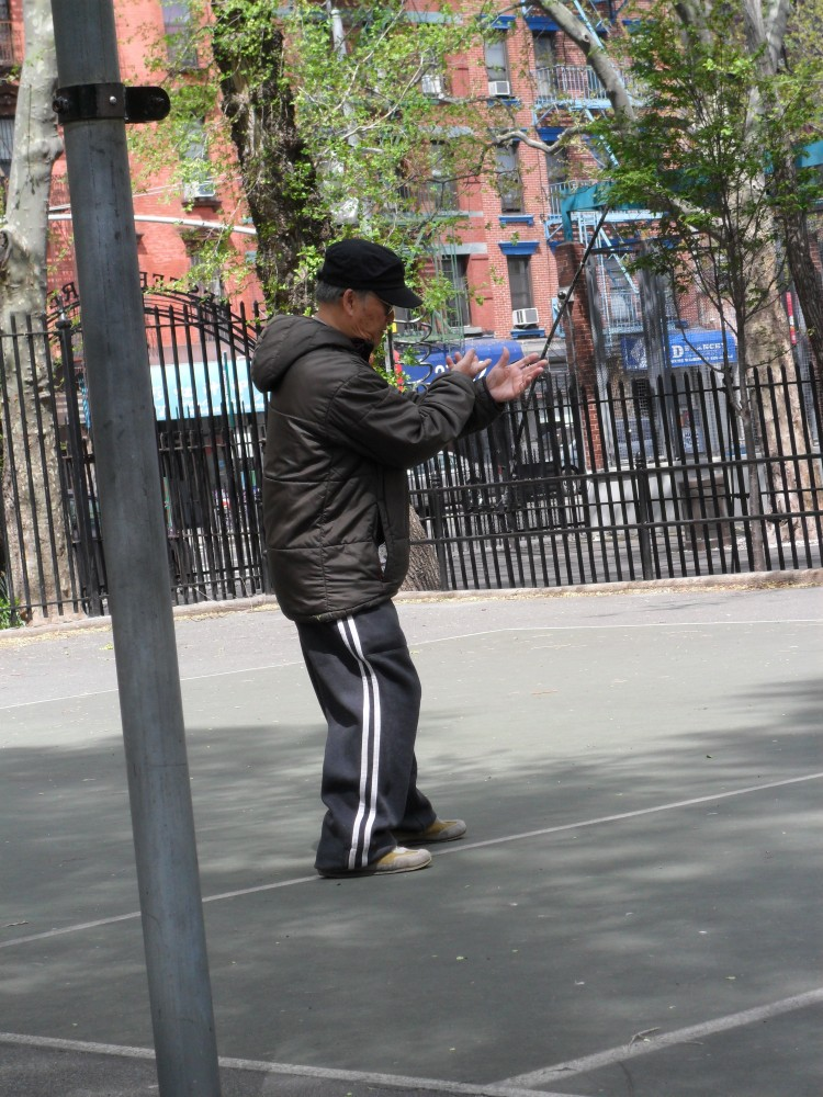 Men like the one above concentrate intensely on the slow movements of tai chi practice
