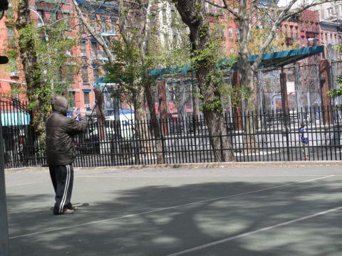 An elderly man practicing tai chi