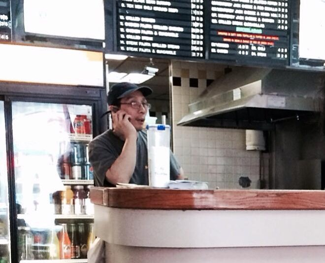 Chinese worker at Taco Bandito. This employee speaks fluent English. He takes orders through the telephone, cleans the restaurant, and also prepares food.