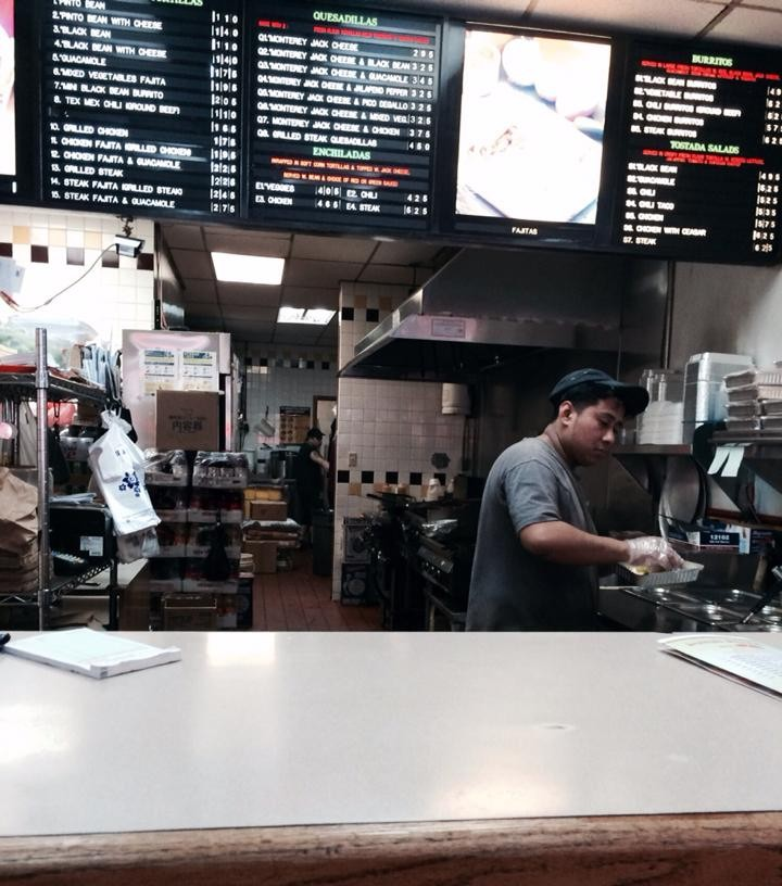 Mexican worker at Taco Bandito. This employee is fluent in both English and Spanish. In addition to taking orders, he occasionally prepares the food.