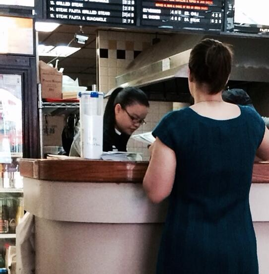 Chinese worker at Taco Bandito. This employee speaks English fluently. She takes orders and prepares the meals, as well.