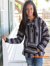 A young woman wearing a baja jacket